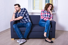 Relationship and conflict concept - unhappy couple after quarrel. At home Stock Images