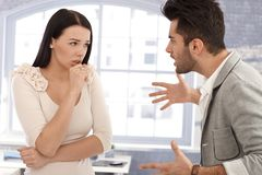 Relationship crisis. Young couple arguing, men shouting at woman Royalty Free Stock Photo
