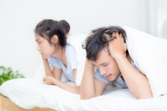 Relationship difficulties, conflict and family concept. Unhappy couple having problems at bed - lover with conflict and stress on bedroom Stock Image