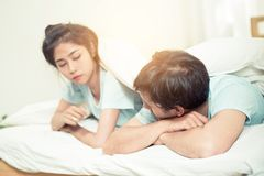Relationship difficulties, conflict and family concept. Unhappy couple having problems at bed - lover with conflict and stress on bedroom Stock Images