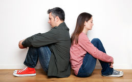 Relationship difficulties. Young couple having relationship difficulties Stock Image