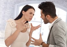 Relationship difficulties. Young couple having a row, quarrelling stock images