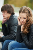 Relationship difficulties of young people couple. Problem depression relationship difficulties of young couple people outdoors Stock Photo