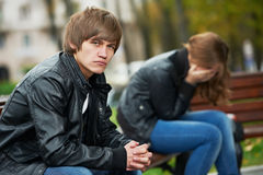 Relationship difficulties of young people couple. Problem depression relationship difficulties of young couple people in outdoors Royalty Free Stock Image