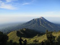 Love in Mountain. Couple in Merbabu mountain with the view of Merapi in Central Java Indonesia stock photo