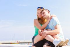 Man and woman sitting together outside stock photography