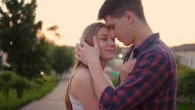 Happiness couple kiss sunset man woman hug