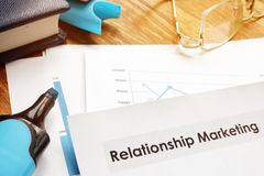 Relationship marketing report and note pad. Relationship marketing report and  the note pad stock photos