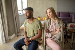 Relationship problems concept. Young mixed race couple quarelling at home. stock photography