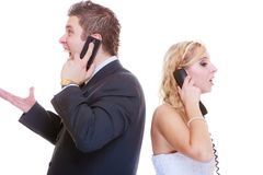 Groom and bride calling to each other stock photo