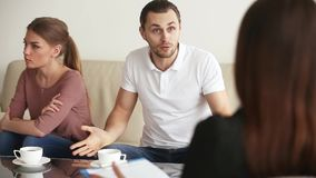 Relationship therapy session. Family facing relationship difficulties. Young couple visiting professional marital therapist office, fighting with each other at stock video footage