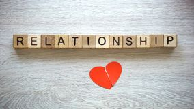 Relationship word on cubes, broken heart connected, reconciliation after parting stock image