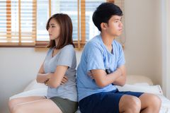 Relationship of young asian couple having problem on bed in the bedroom at home, family having conflict argument with unhappy. Men and women with issue stock images