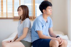 Relationship of young asian couple having problem on bed in the bedroom at home, family having conflict argument with unhappy. Men and women with issue royalty free stock images