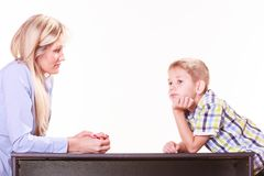 Mother and son talk and argue sit at table. Stock Image