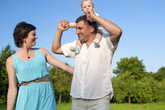 Relationships Concepts. Young Caucasian Family of Three People Embracing. Relationships Concepts. Young Caucasian Family of Three People Having Good Time Royalty Free Stock Image