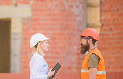 Relationships construction client and participant building industry. Discuss progress plan. Construction industry stock photo