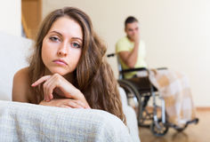 Relationships difficulties in wheelchair Stock Images