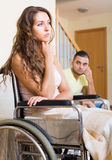 Relationships difficulties in wheelchair Royalty Free Stock Images