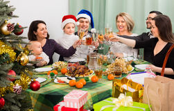 Relatives celebrate Christmas at  table Stock Photo