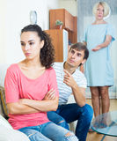 Relatives quarrelling with young woman in domestic interior Royalty Free Stock Images