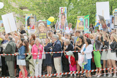 Relatives to the graduating teenagers waiting outside school wit. STOCKHOLM, SWEDEN - JUN 10, 2015: Relatives to the graduating teenagers waiting outside school Stock Photos