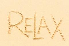 Relax написанный на песке Стоковое фото RF