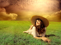 Relax. Beautiful woman on a grass field Stock Photos