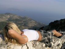 Relax. Girl relaxing at the top of pantokrator Royalty Free Stock Image