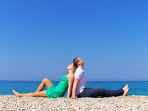 Relax. Two young people repose on sea beach Royalty Free Stock Image