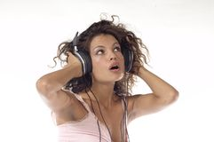 Relax. Woman dancing with headphone and smiling her face Royalty Free Stock Images