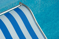 Relax. Chair by a Swimming Pool Royalty Free Stock Image