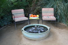 Relax. Resting area with cozy chairs, a fountain and a fruit bowl Stock Photo