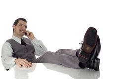 Relax. Young business men sitting and talking on mobile phone Royalty Free Stock Photo