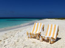 Relax. Two chairs at the beach in a tropical island Royalty Free Stock Images