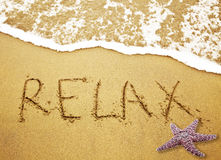Relax. Written in Sand on Beach with a Starfish stock photography
