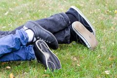 Relax. Young  people relaxing in the park Royalty Free Stock Photography