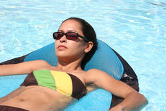 Relax. Girl relaxing in the pool Royalty Free Stock Photography