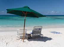 Relax. Canvas chair and sun shade on a beautiful caribbean beach Stock Images