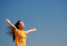 Relax. Young Woman Relaxing over blue sky Royalty Free Stock Photo