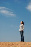 Relax. Young Woman Relaxing over blue sky Royalty Free Stock Photos