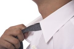 Relax. Man loosining his necktie Stock Photo