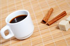 Relax. Coffee cup with cinnamon stick and cane sugar Royalty Free Stock Photography