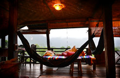 Relax balcony at vangvieng laos. Relax balcony at vangvieng the countryside of laos photo indoor dark light and dark shadow the lighting is from outside low Royalty Free Stock Photography