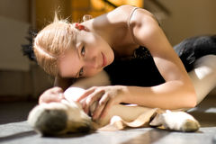 Relax of ballerina. Young ballerina is relaxing in class room Stock Images