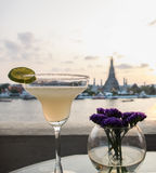 Relax in Bangkok on Holiday Concept, Glass of Margaritas with Wat Arun in Background while Watching Sunset Stock Photo