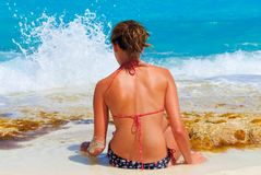 Relax on the beach. Young girl sit and relax on Cancun beach Stock Images