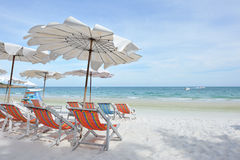 Relax on the beach. White umbrella and shairs on sand beach in tropic royalty free stock images