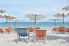 Relax on the beach. White umbrella and shairs on sand beach in tropic stock photography