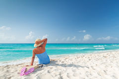 Relax on the beach. Woman in hat relaxing on holiday at Caribbean Sea Royalty Free Stock Image